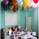 Fill 30 balloons with helium and attach a ribbon with a photo for each year of the person's life