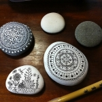 Draw beautiful, intricate designs onto flat pebbles with artist pens